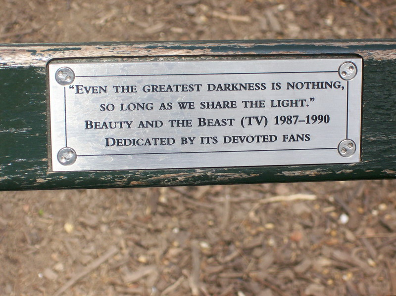 "closeup of bench inscription: ""Even the greatest darkness is nothing, so long as we share the light. Beauty and the Beast (TV) 1987-1990 Dedicated by its devoted fans"""