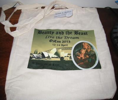 white canvas bag with con logo