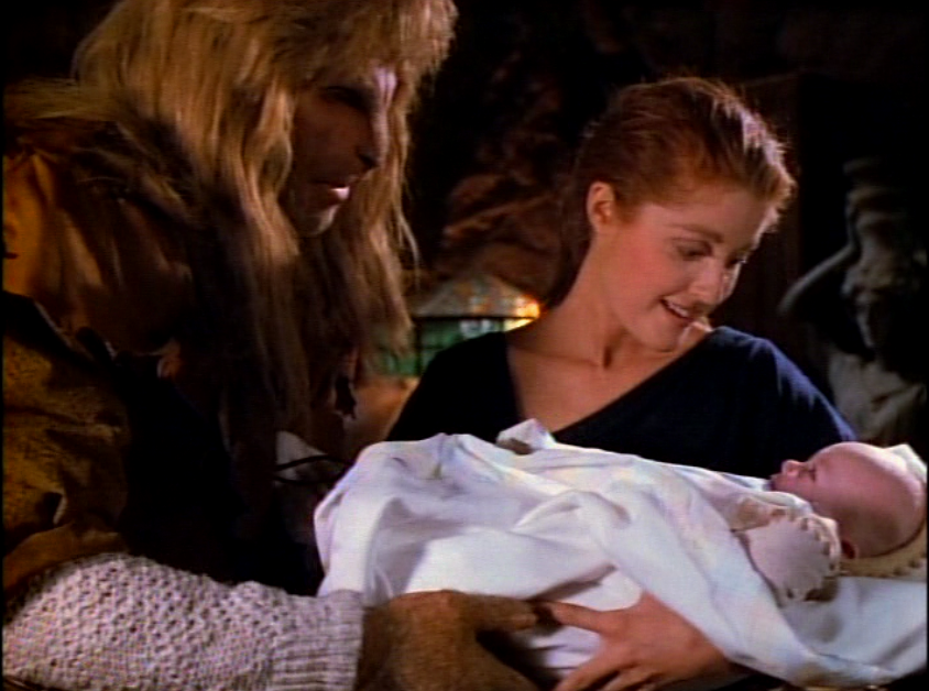 Vincent, Diana, and baby Jacob share a moment of connection and love in Vincent's chamber